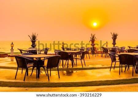 Empty table and chair with sea and sunset background - Vintage Filter