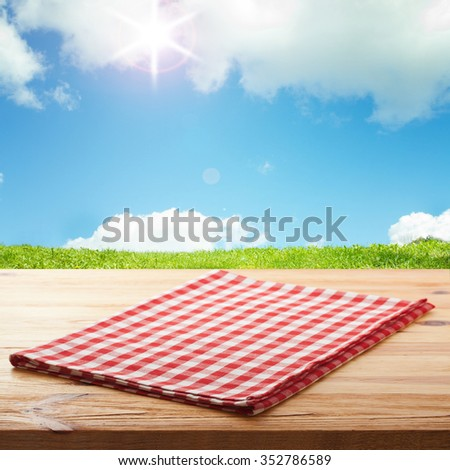 Empty table and red tablecloth, Blue summer sky with clouds as a background, for product display montage