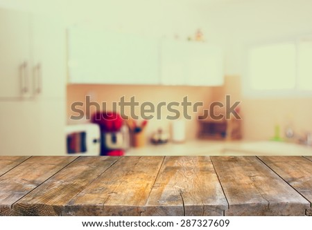 empty table board and defocused white retro kitchen background - stock photo