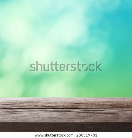 Empty table on nature background. - stock photo