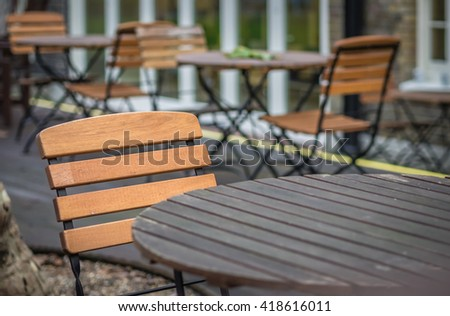 Empty table outside local caf�© in London - stock photo