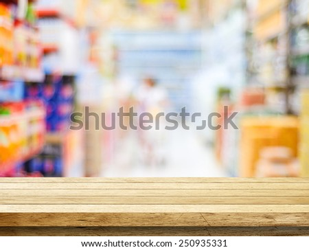 Empty table over blur supermarket with bokeh background,  product display template. - stock photo