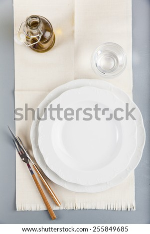 empty table set , olive oil, on grey - stock photo