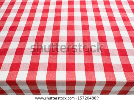 empty table top view covered by red gingham tablecloth - stock photo