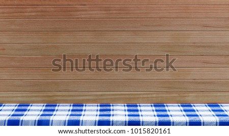 Empty Table With Blue Checked Tablecloth Over Wooden Background. Kitchen  Background