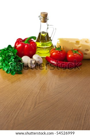 Empty table with ingredients  and space for your salad or pizza - stock photo