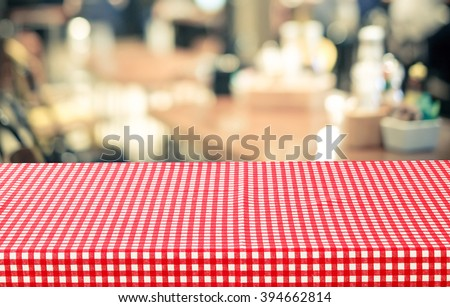 Empty Table With Red Check Table Cloth Over Blurred Cafe With Bokeh  Background, Food And