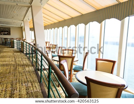 Empty tables at a luxury cruise restaurant - stock photo
