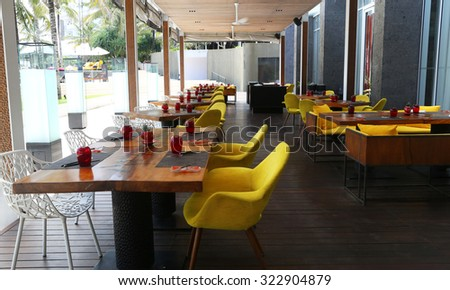 Empty tables at outdoor restaurant - stock photo