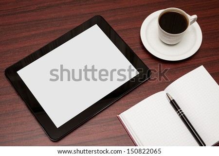 empty tablet and a cup of coffee on the desk - stock photo