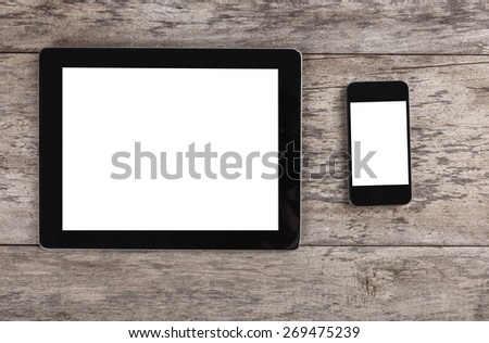 empty tablet and smart phone  on the wooden table - stock photo