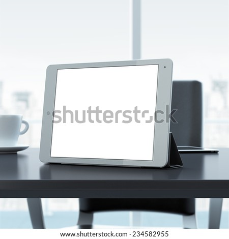 Empty tablet on office table - stock photo