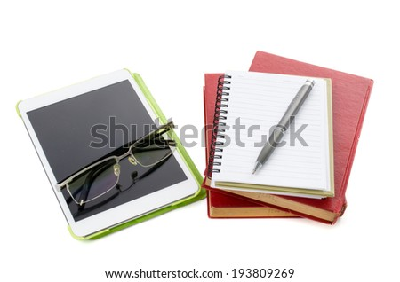 empty  tablet pc and with note book on white background .