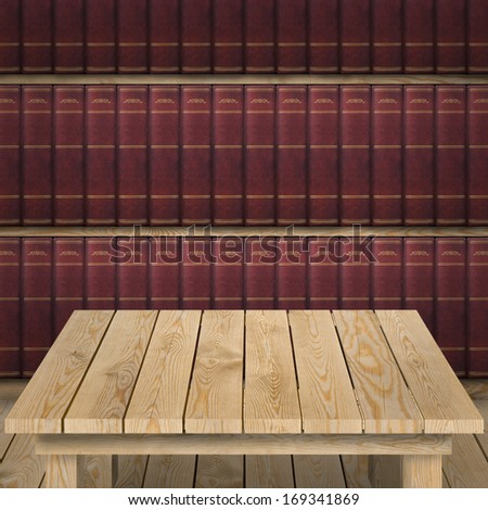 Empty tabletop and bookshelf with old hardcovered books in the background - stock photo