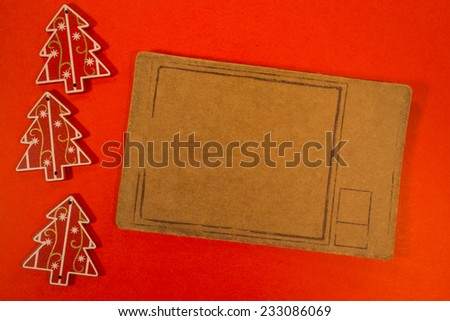Empty tag with Christmas decorations on red background. Three Christmas decoration with pricetag - stock photo