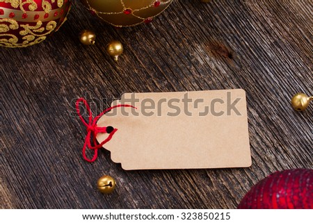 empty tag with red bow in frame of christmas decorations