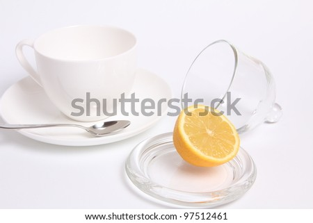 Empty tea cup and fresh lemon isolated
