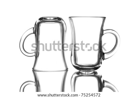 Empty tea glasses  in front of white background - stock photo