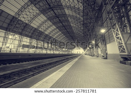 Empty terminal railway station at night time. - stock photo
