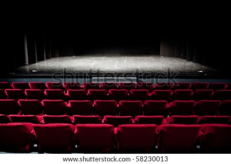 empty theatre with red seats - stock photo