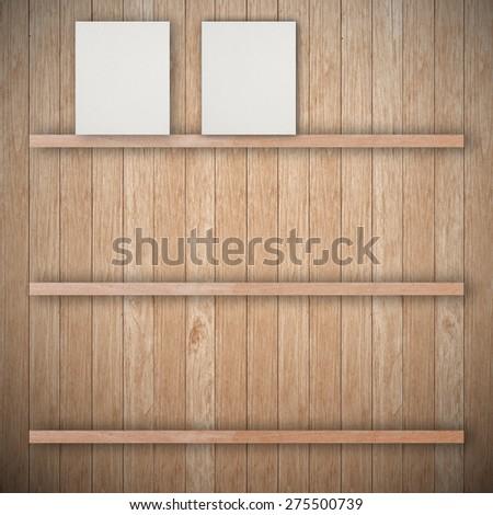 Empty three wood shelf and empty paper - stock photo