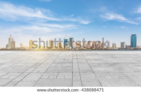 empty tiled floor with city skyline under cloudy sky,chongqing china. - stock photo