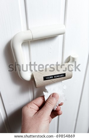 empty toilet paper roll with funny message on it - stock photo