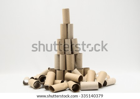 Empty Toilet Rolls Stack Up On a Black Background - stock photo