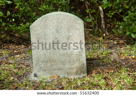 Empty tombstone on a graveyard - stock photo