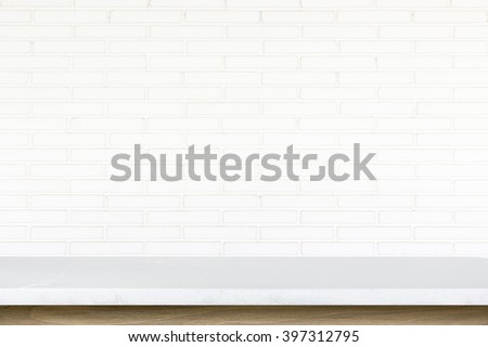Empty top of stone table on white brick wall background. For product display