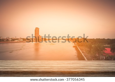 Empty top of wooden table and view of sunset or sunrise background. For product display