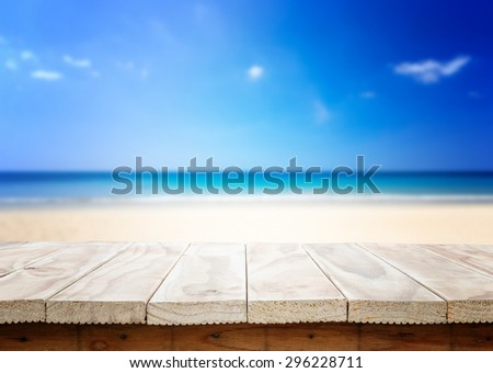 Empty top of wooden table or counter and view of tropical beach. For product display - stock photo