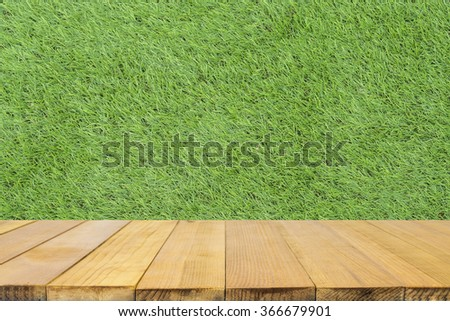 Empty top wooden shelves and  top wooden shelves and Wood table top with  Green grass background- can be used for montage or display your products  - stock photo