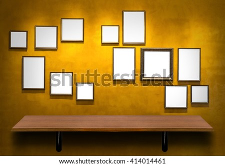 Empty top wooden shelves on Vintage wall background with photo frame.Product presentation with interior concept