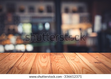 Empty top wooden table and blur with bokeh background. For product display - stock photo