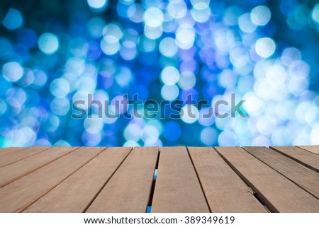 Empty top wooden table and blurred image of christmas lighting bokeh background. for your product display - stock photo