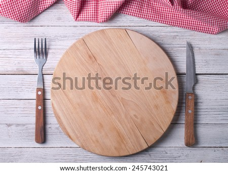 Empty tray on tablecloth on wooden table - stock photo