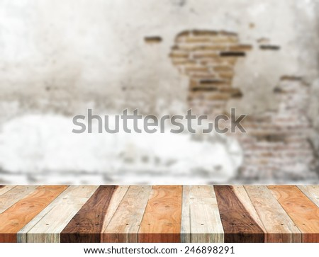 Empty tropical wood table and blurred crack concrete wall, product display template.Business presentation - stock photo