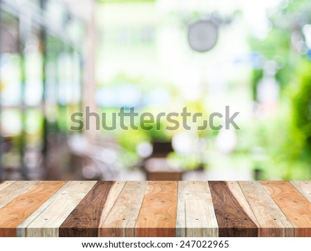 Empty tropical wood table and blurred garden cafe light background. product display template.Business presentation - stock photo