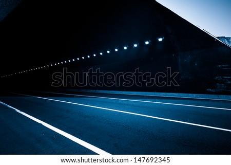 empty tunnel, blue toned image. - stock photo