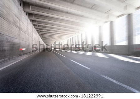 Empty tunnel road with motion blur - stock photo