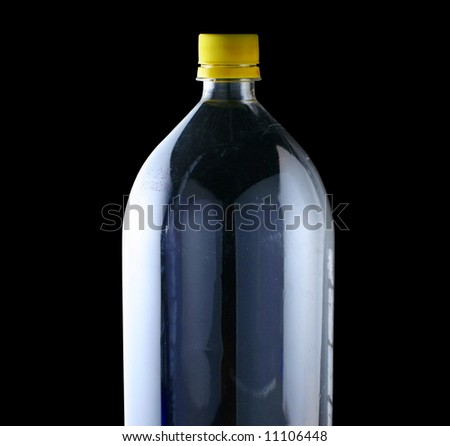 empty two liter bottle on black - stock photo