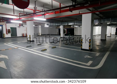 Empty underground parking lot - stock photo