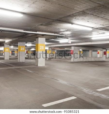 Empty underground  parking lot area - stock photo