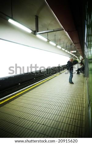 Empty underground station with blank advertisements. - stock photo