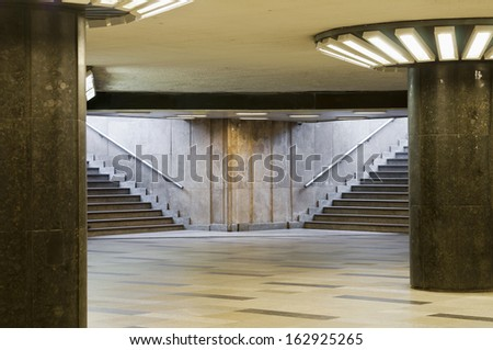 Empty underpass with columns and steps - stock photo