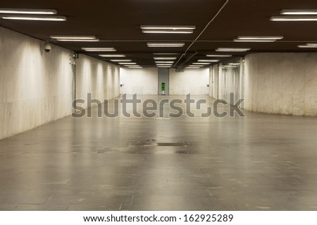 Empty underpass with lights and grey tiled - stock photo