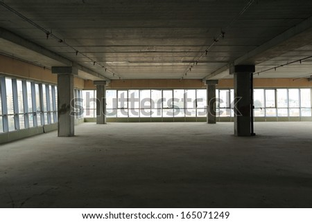Empty unfinished office building construction site - stock photo