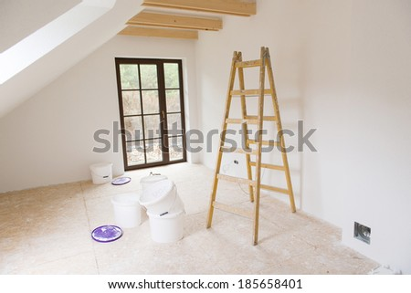 Empty unfinished room with white walls in a new constructed house - stock photo