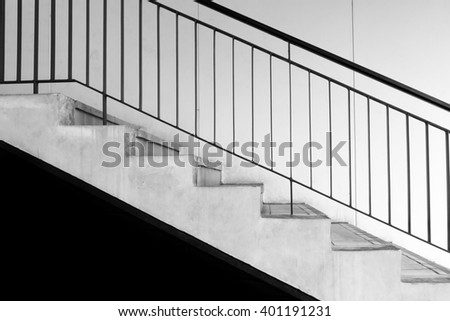 Empty university or hospital building stairway in front of a concrete wall in black and white color - stock photo